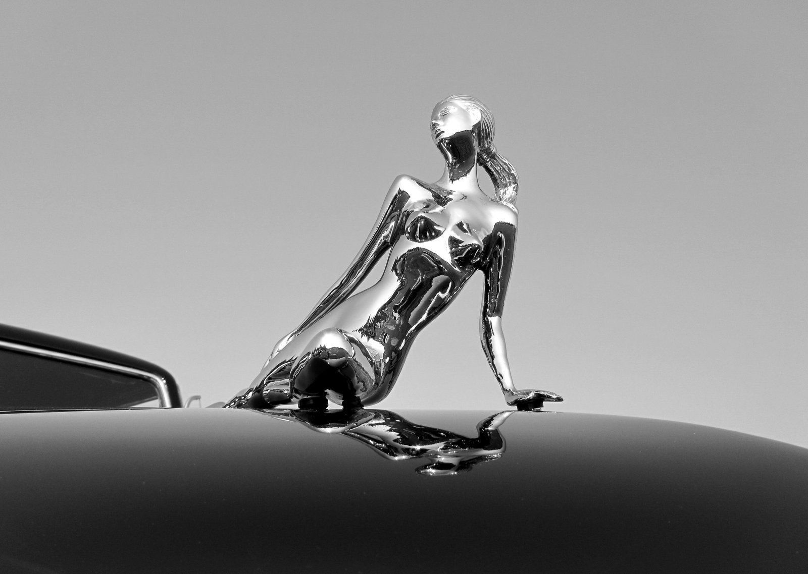 Wing hood ornament - A Spectacular Casting Of A Reclining Nude Woman Finished In Highly Polished Chrome Adorning The Hood Of A 1948 Lincoln Continental With A Deep Black Paint