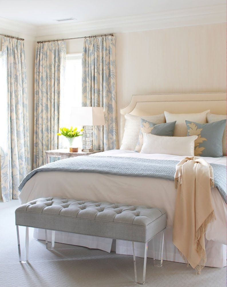 Bedroom In A Cottage With Blue And Cream Floor Length Curtains