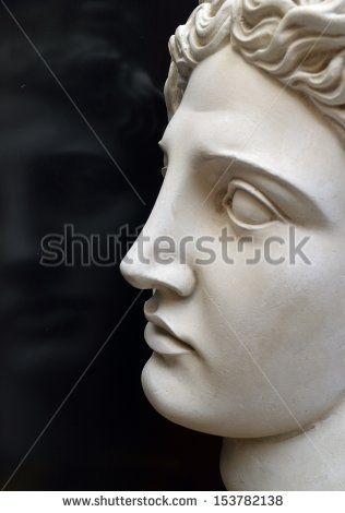 Apollo's reflection (head sculpture) - stock photo