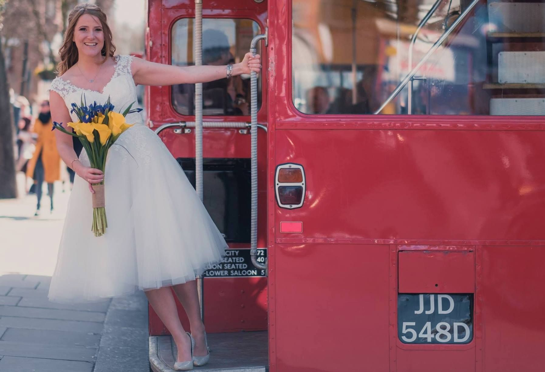 Have you ever thought of getting a old London bus to your wedding? Over in True Bride HQ we love this fabulous chic and sassy photo! Congratulations to our newly wedded bride Kirsty wearing 'Lottie' from the Brighton Belle collection featuring a delicately beaded lace bodice and full Fifties style tulle skirt.