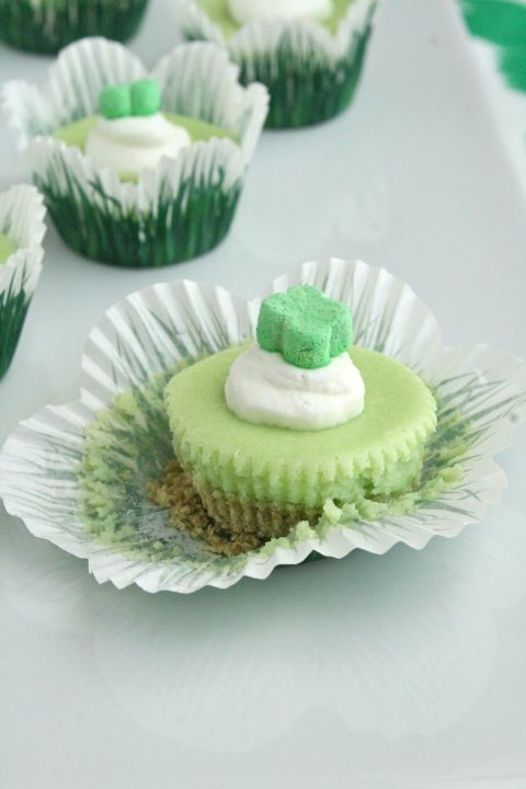 Miniature Lucky Charm Cheesecakes are topped with a marshmallow charm, will perfectly finish off your dinner.