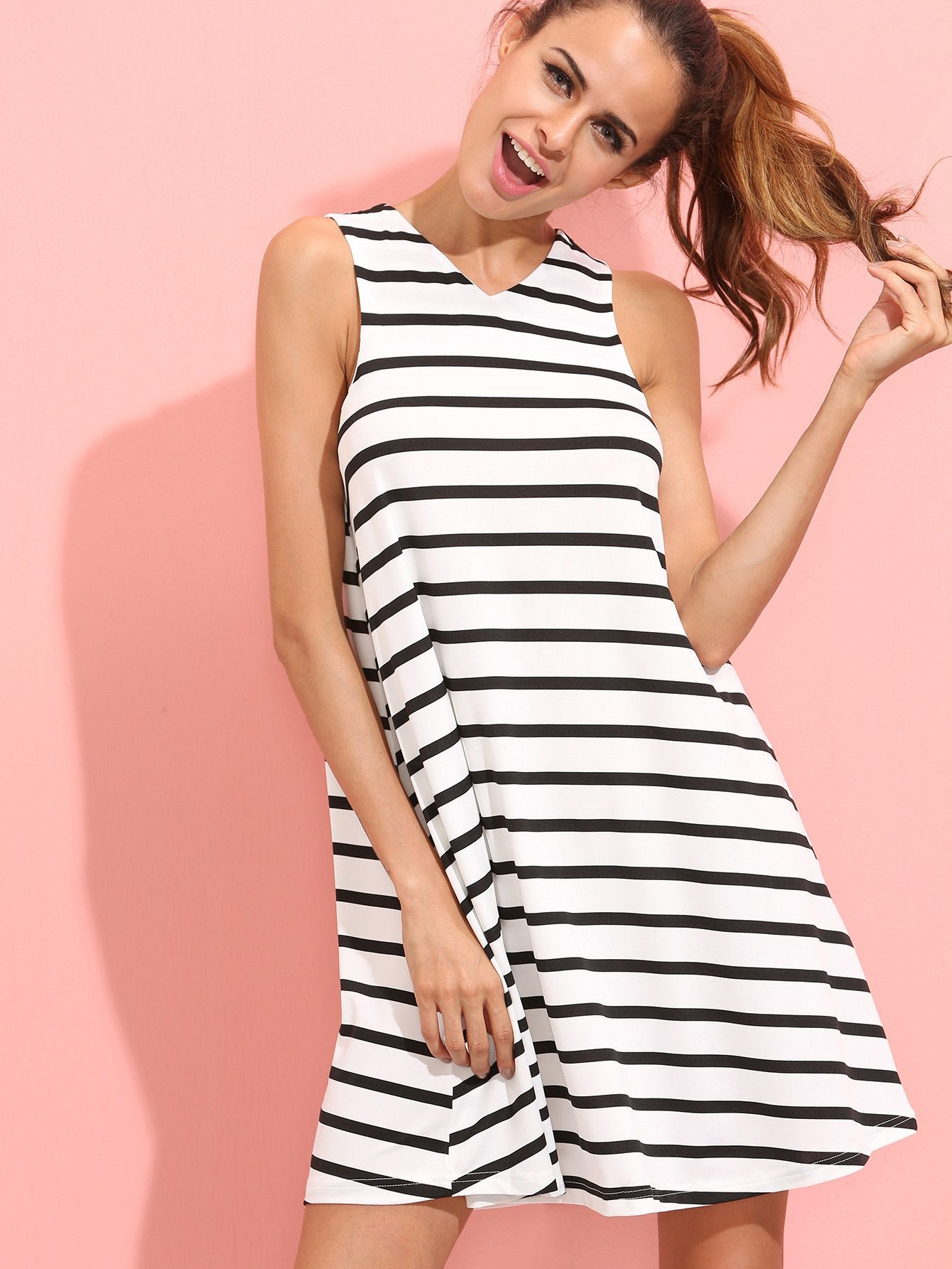 Fabric: Fabric has no stretch Season: Summer Type: Tunic Pattern Type: Striped Sleeve Length: Sleeveless Color: White Dresses Length: Short Style: Casual Material: Polyester Neckline: V Neck Silhouett