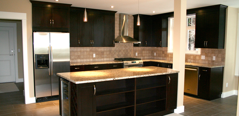 Maple Shaker With An Espresso Stain With Giallo Ornamental Granite Countertops And Travertine