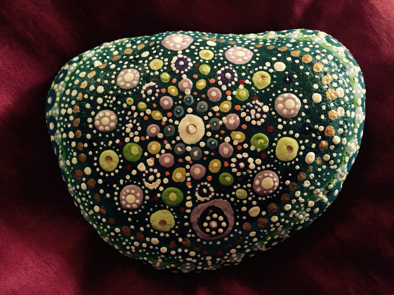An irregular mandala on an irregular stone.