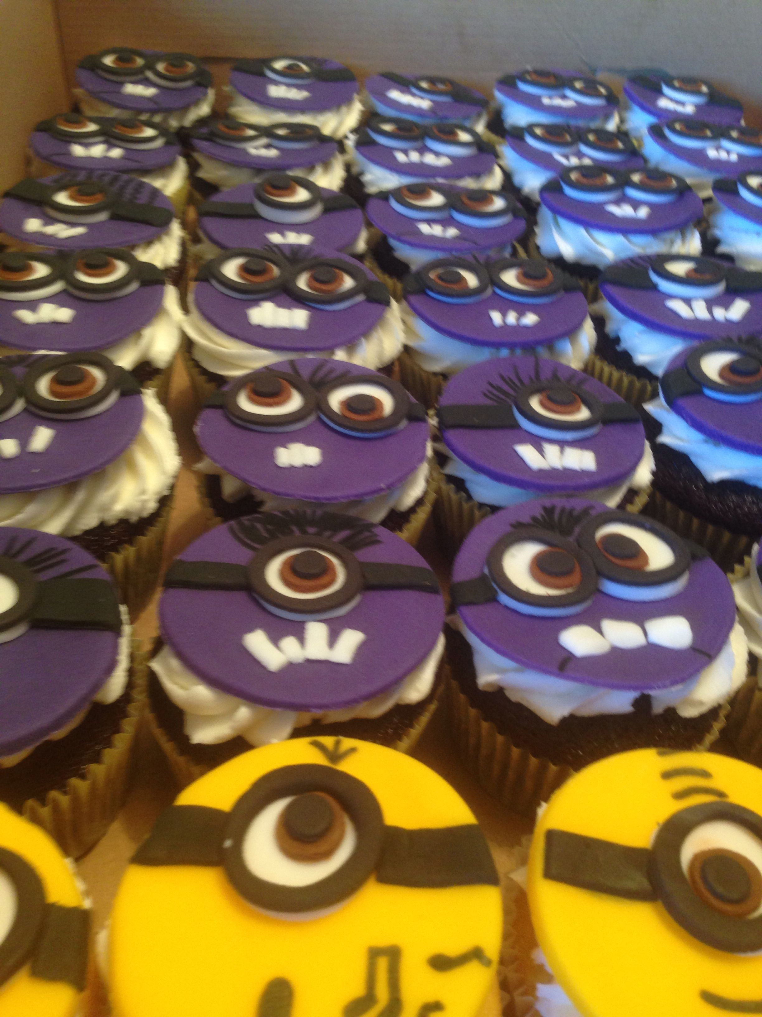 Purple Minion cupcakes. Chocolate cake with vanilla frosting topped with a fondant topper.