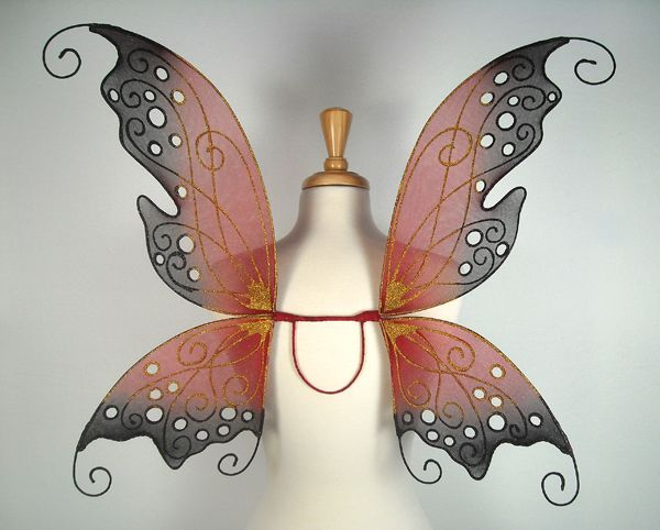 Dawn fairy wings from On Gossamer Wings http://www.fairy-wings.com/  In oranges and greens perhaps.