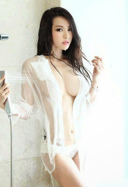 Sexy asian girl in white wet shirt big boobs