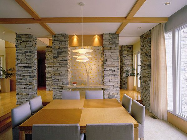 like this idea of interior stone columns to accent the house