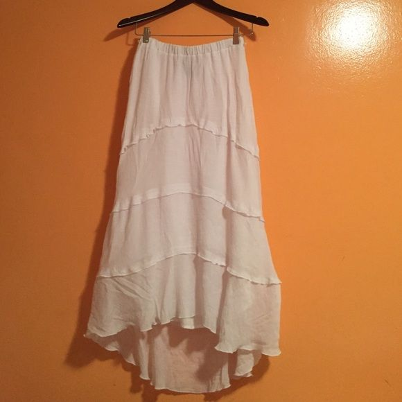BEAUTIFUL WHITE SKIRT This is a beautiful skirt. The material is very elegant. I always get compliments every time I wear it. I'm sad to let it gobut it too tight on me. BCX Skirts High Low
