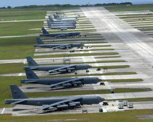 B-52s and other US aircraft lined up on the runway at Andersen Air Force Base on Guam.