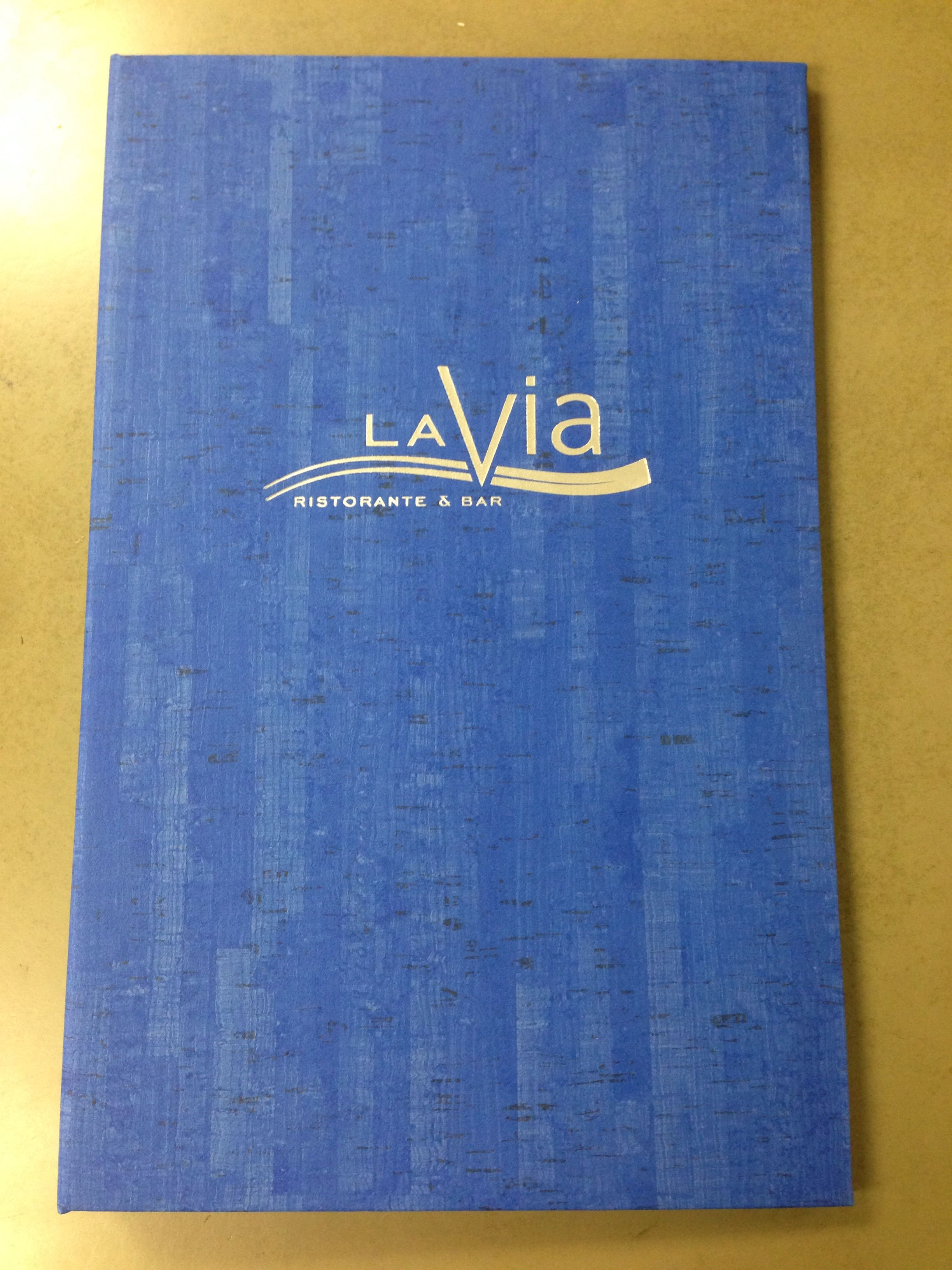 blue simulated cork menu with silver foil stamp and deboss logo