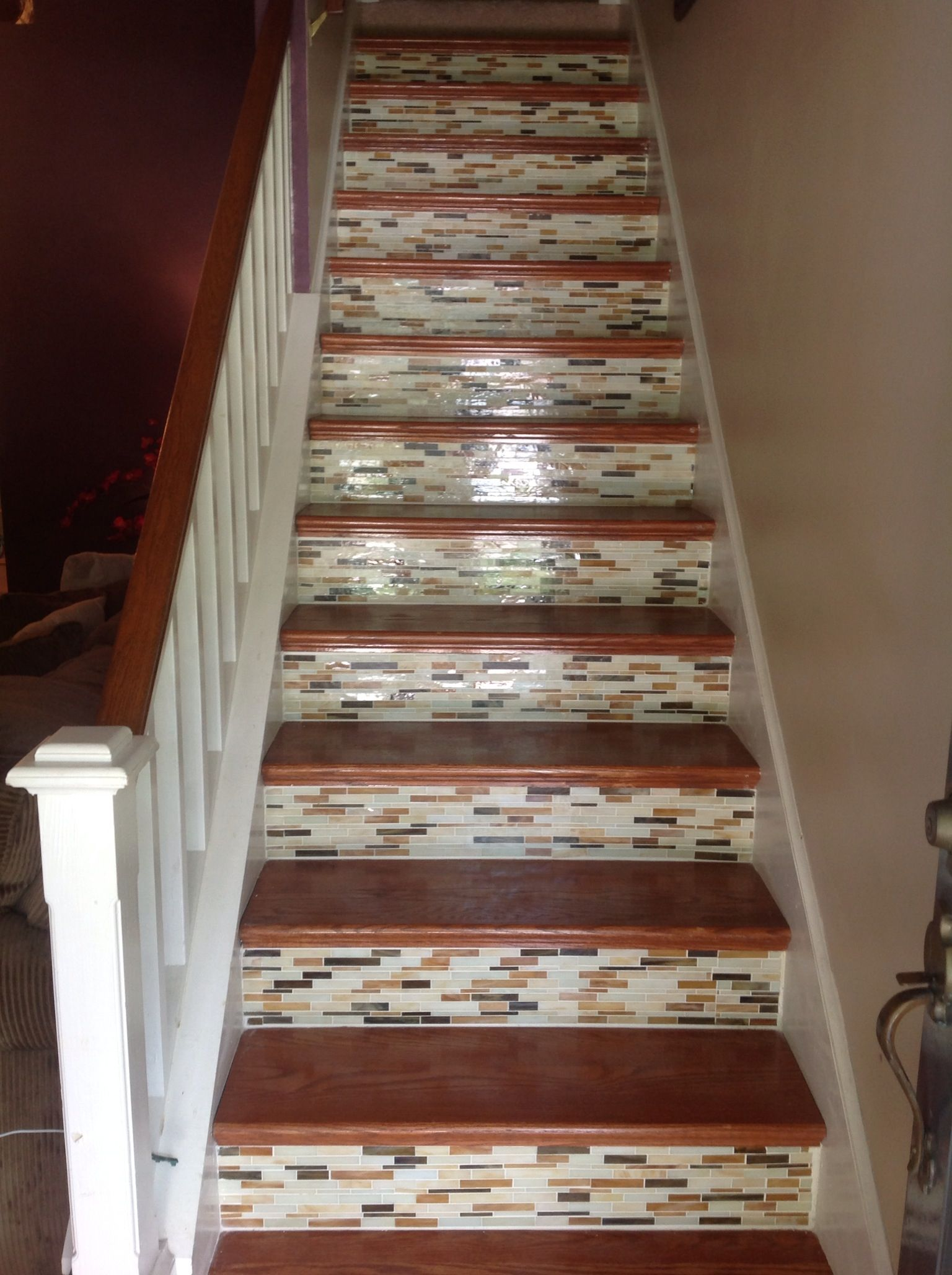 we used glass back splash tiling for the kick plate for our stairs we used clear liquid nails