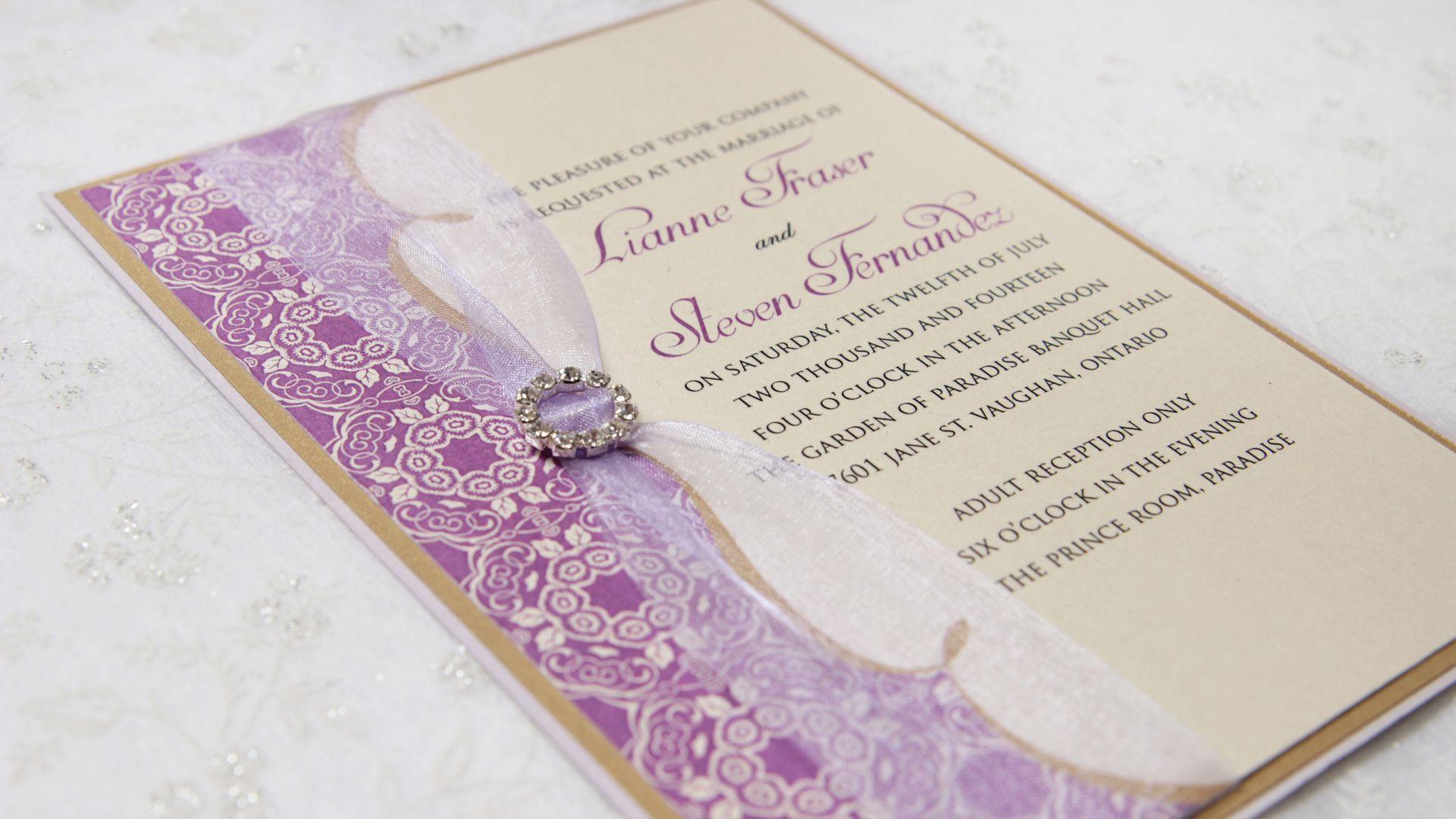 Beautiful purple flower print pattern design with jewel brooch on