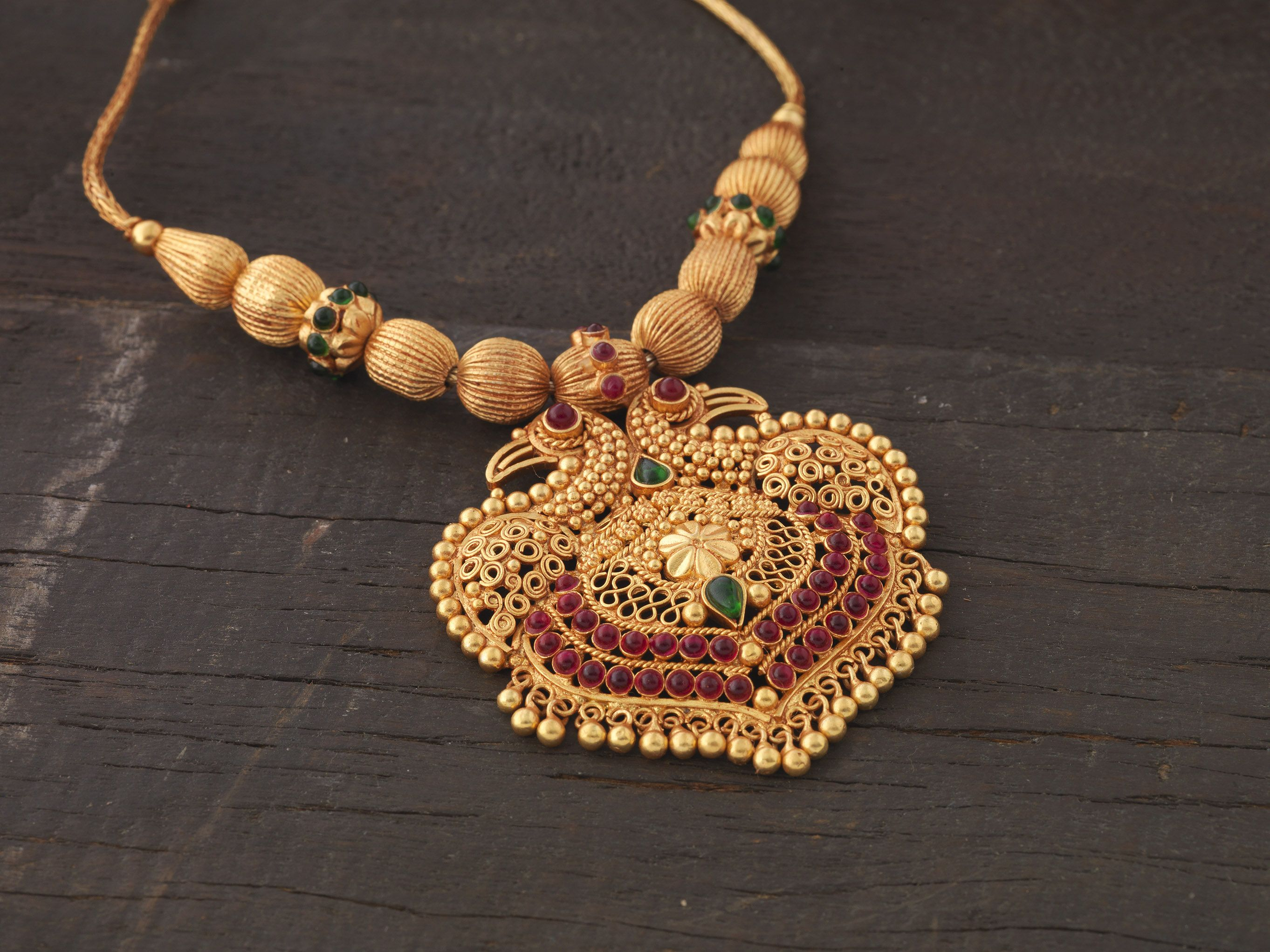 Silver temple jewellery with gandaberunda pendant gold jewels