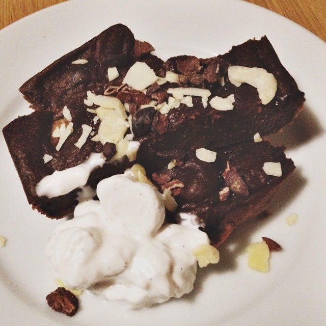 Avocado, beetroot & cacao brownies with cacao nibs, flaked almonds and vanilla coyo.