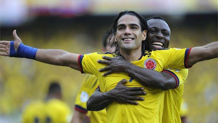 pablo armero maria bazan | (front) celebrates with teammate Colombian defender Pablo Armero ...