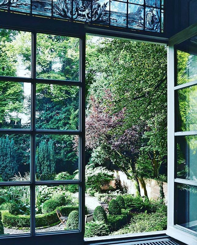 2c95593c68fc3 Reposting  fohlio  One of the best things about summer is the lush  greenery  formal garden from the windows of the Viktor   Rolf headquarters.