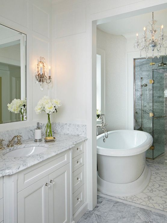Elegant Sophisticated Bedroom Features Paneled Walls Framing White Lacquer Mirror Flanked By French Sconc Small Spa Bathroom Bathrooms Remodel Trendy Bathroom