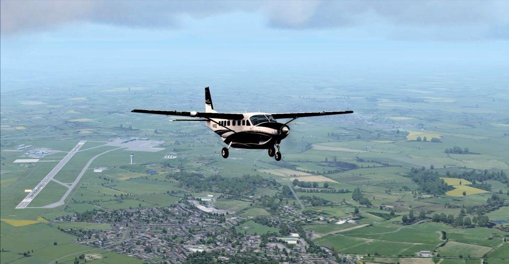 Cessna Grand Caravan in flight North of Newcastle Intl  Airport