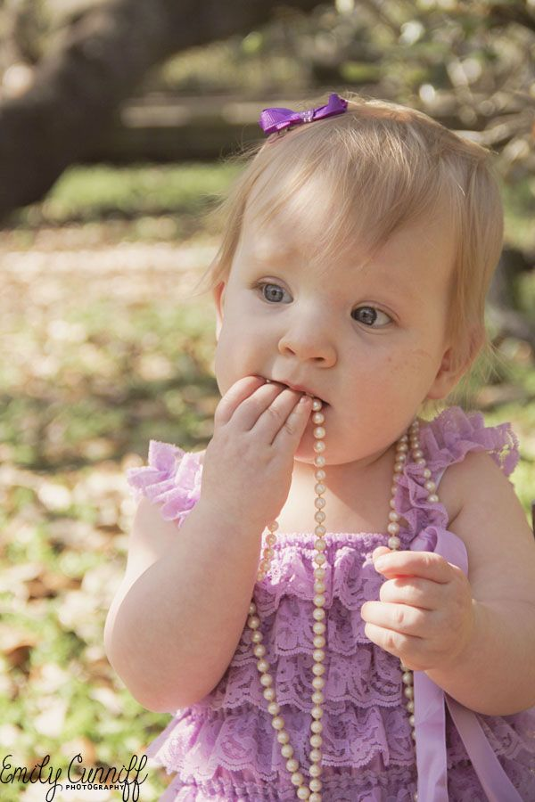 Photography: Emily Cunniff Photography | 2015 One Year Old Photo Shoot Jacksonville, FL  #emilycunniffphotography #photography #childrensphotography #jaxphotographer #oneyearoldphotoshoot #babygirl #oneyearold #naturallight #jacksonville #florida #pearls #purple