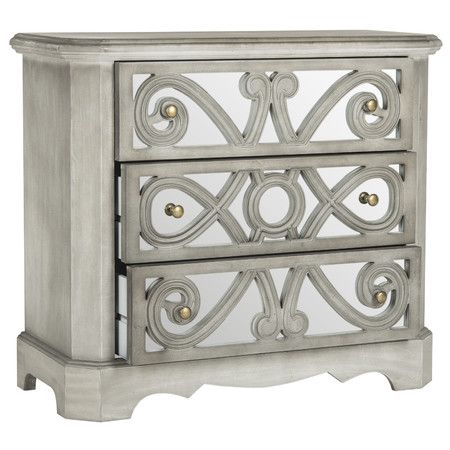 Elegantly stow linens and silver in this eye-catching chest, featuring mirrored drawer panels for a touch of shimmer.Product: Che...