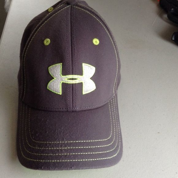 Under Armour Hat Grey baseball hat with silver insignia and neon green. Some pilling on hat ,but still a nice hat with wear left in it. Size Med/ Large Under Armour Accessories Hats