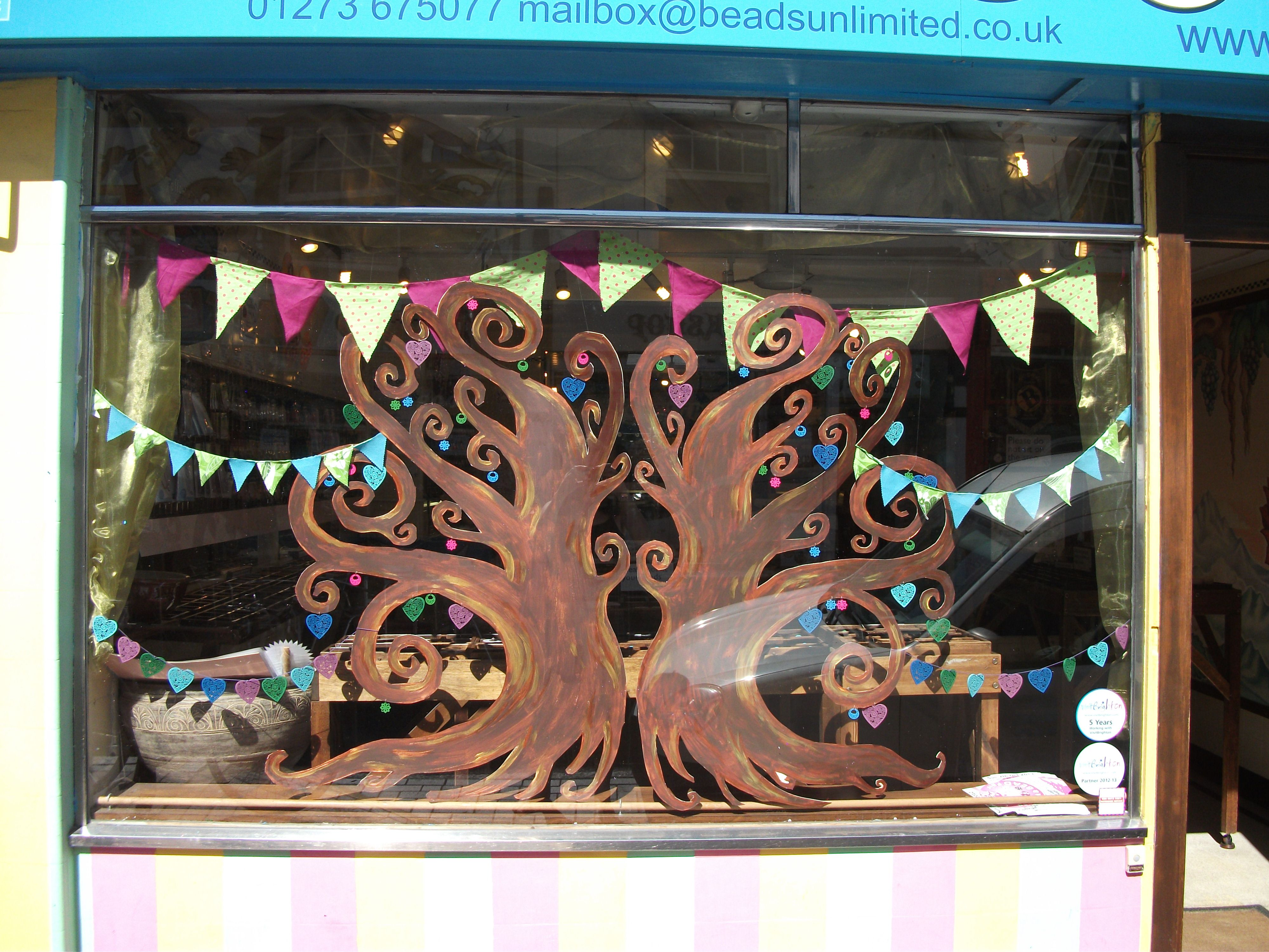 The every popular wooden Hearts, hanging in a tree made for our August window display....