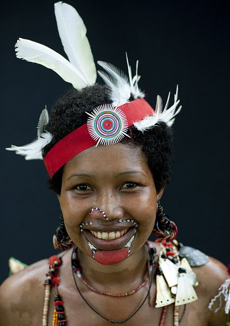 Portrait of a dancer in traditional costume. Trobriand Islands (aka the Kiriwina Islands) ,off the eastern coast of Papua New Guinea in Milne Bay Province. | © Eric Lafforgue