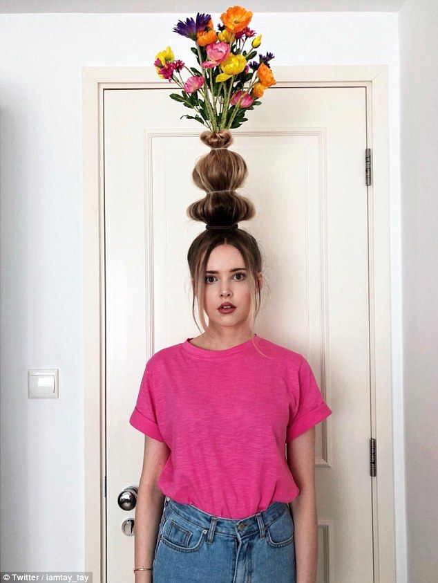 Bizarre social media trend sees women turning  hair into VASES #crazyhairday