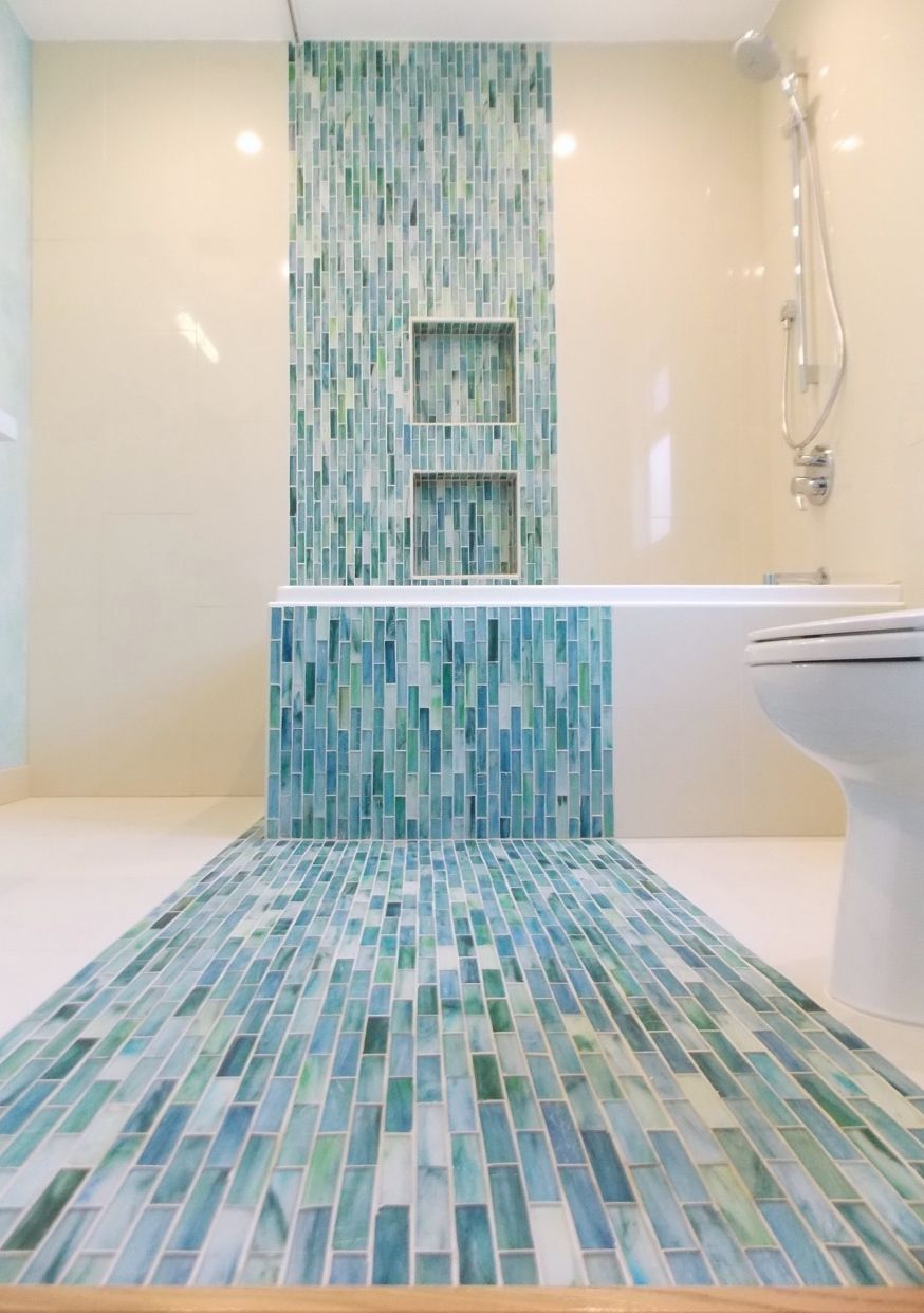 Water fall tile for a client! Plumb Crazy, Inc laying it down in the ...