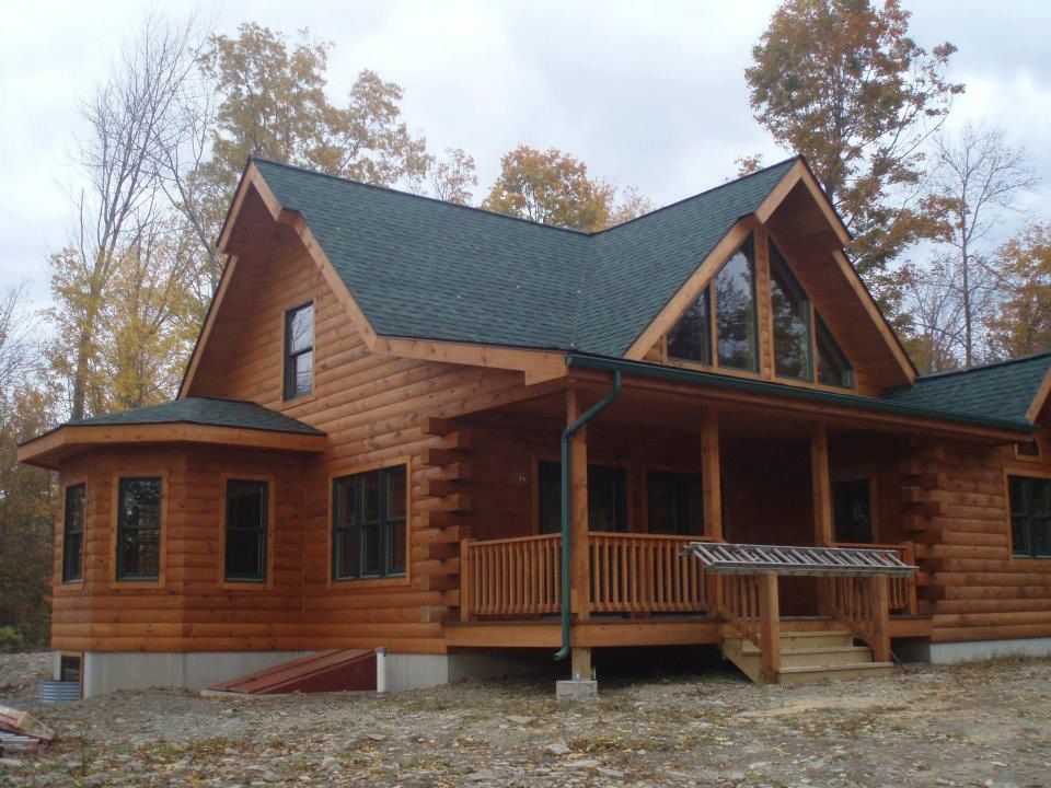 Beautiful -I'd love to see the inside of this log cabin home!