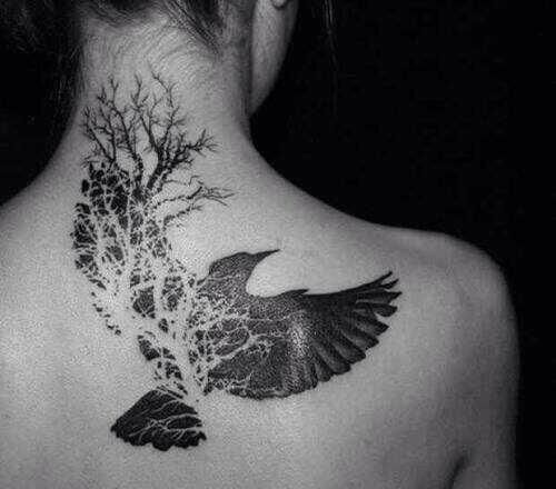 Roots for wings back of neck bird tattoo