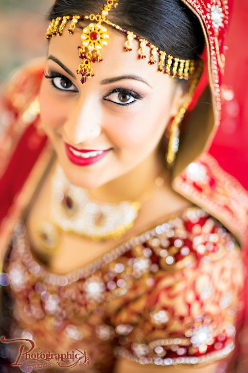 Traditional Indian wedding makeup with red lips on IndianWeddingSite.com