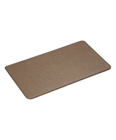 Take a look at this Mocha Mat by Imprint Comfort Mats on #zulily today!  This cushy, waterproof mat features a unique construction that conforms to feet and supports arches when standing. Proven by the Center for Ergonomics to reduce overall fatigue and discomfort, it's a smart investment for busy individuals who spend lots of time standing