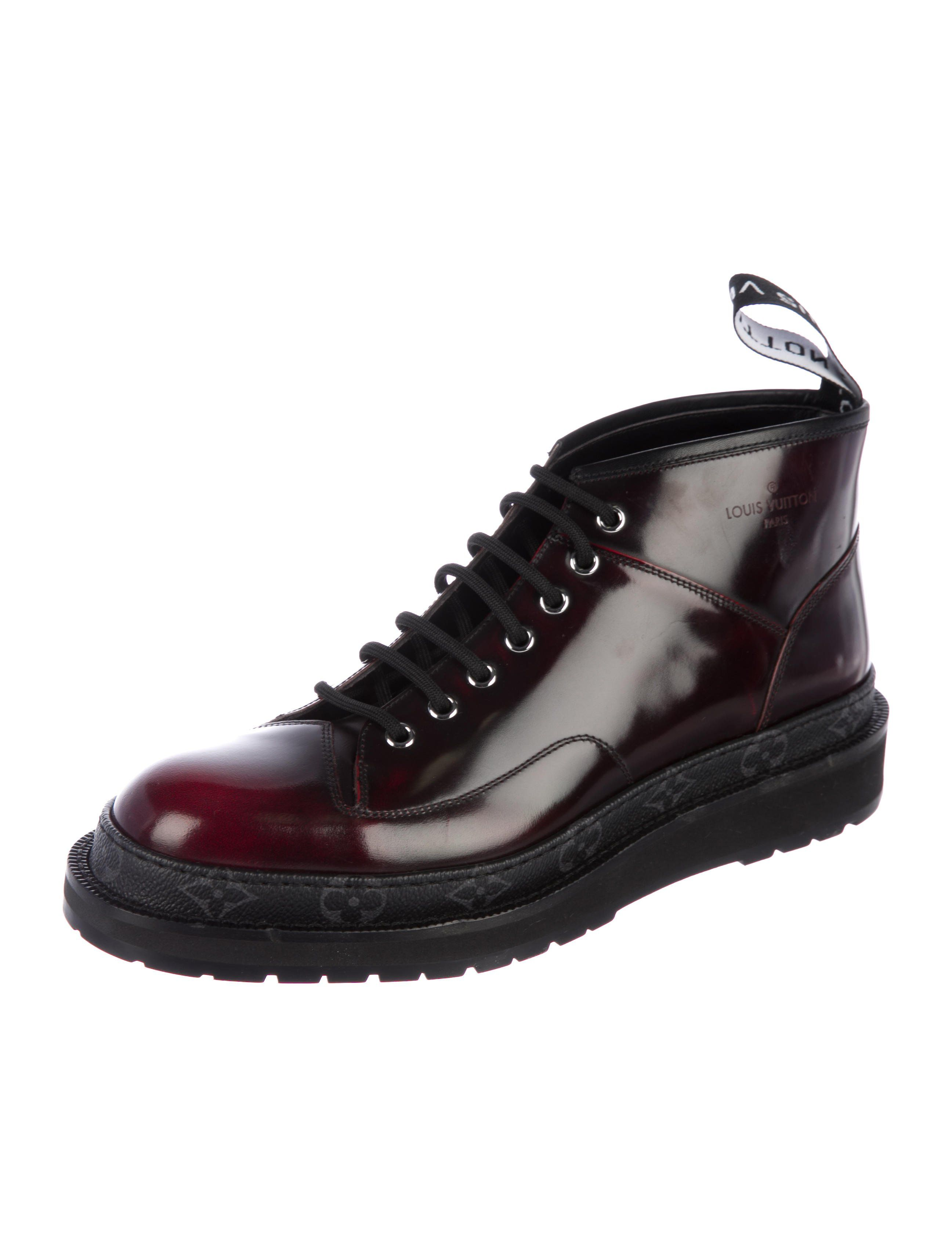 dac56c2247af Men s oxblood leather Louis Vuitton Black Ice ankle boots with extended  pull tabs at counters
