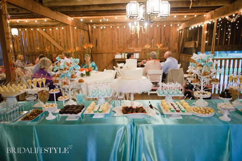 Beautiful cakes spread out for your guests to take and munch on while they enjoy the whole night. Real Oklahoma Wedding from Fall/Winter 2013 BridalifeStyle. Wedding Planner: www.dplazzo.com   Photography: Holli B. Photography   Cakes and Dessert bar: www.mishellehandycakes.com