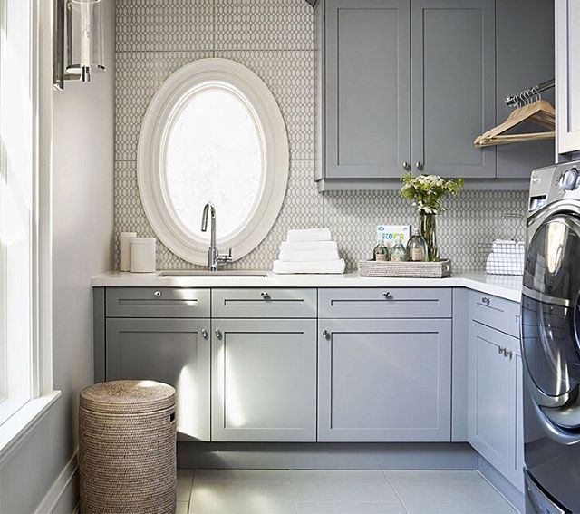 The pale color on the cabinets & gorgeous backsplash make this laundry room designed by @emdesigninc feel like a retreat! What do you think?