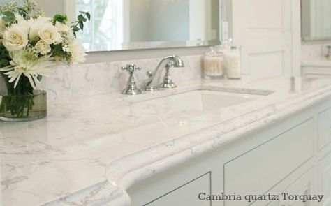 Cambria quartz bathroom countertop looks like Carrara marble - color Torquay; (it's like caesarstone or Silestone)