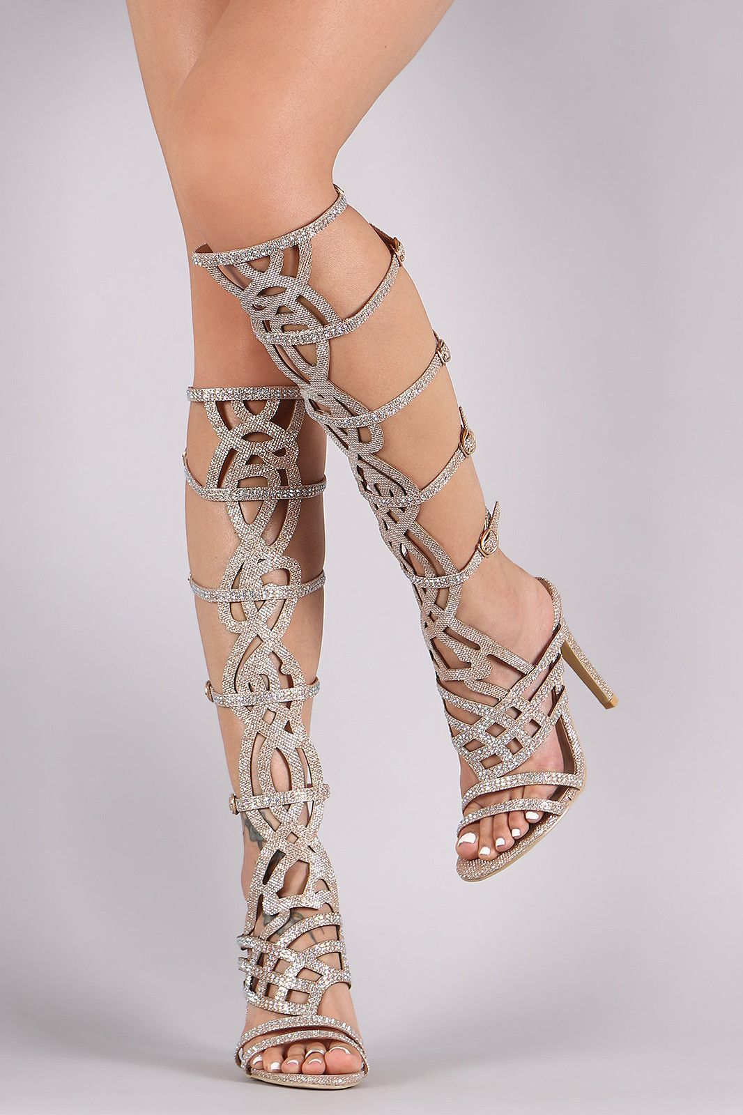 2b41346837cc56 This stunning heel features a strappy caged design shaft