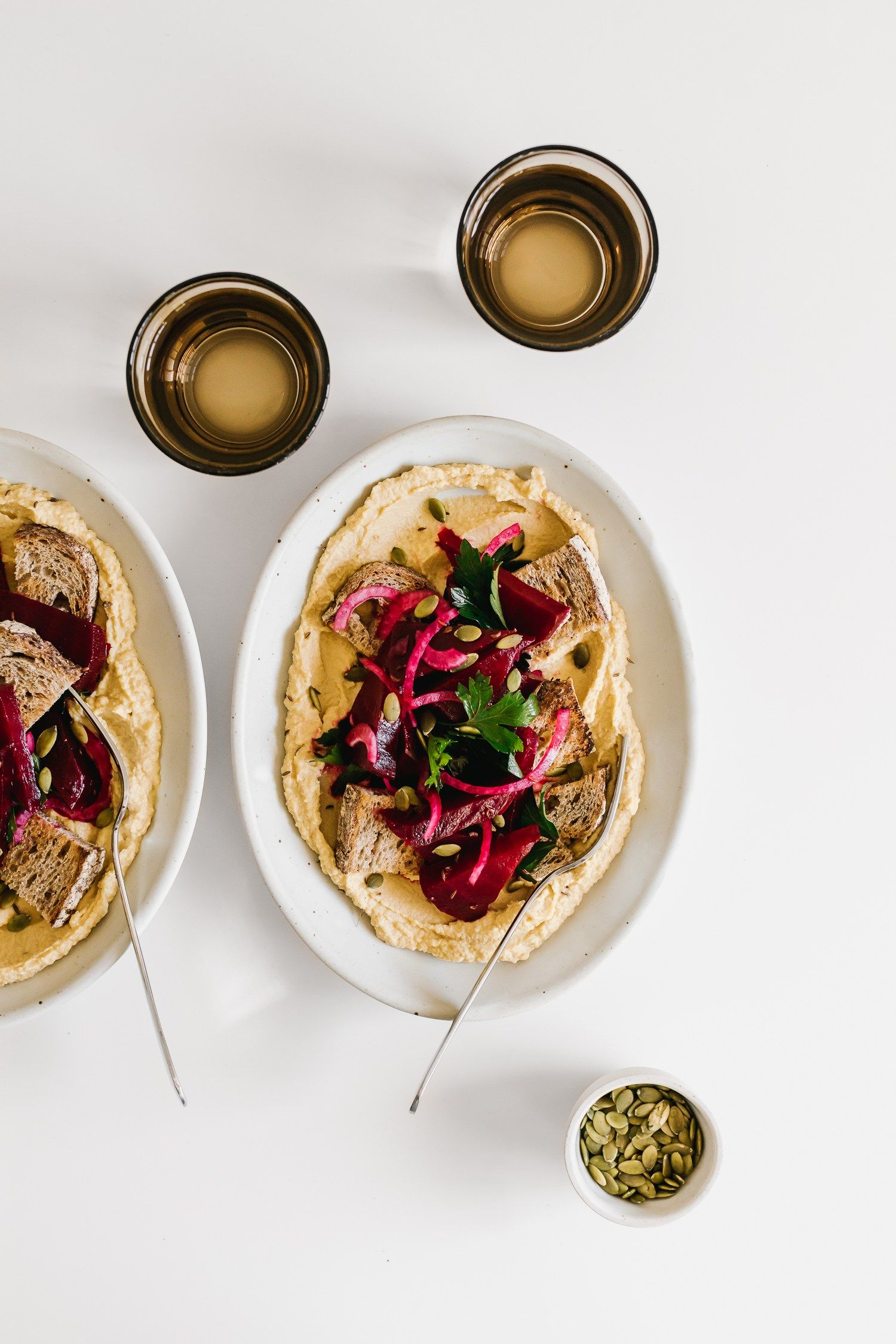 Beet-Centric Hummus & Marinated Salad w/ Toasted Rye & Caraway Seeds by Faring Well