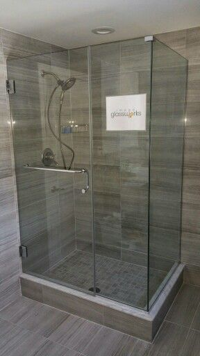Wall Mounted Frameless Shower Door With An Inline Panel And A
