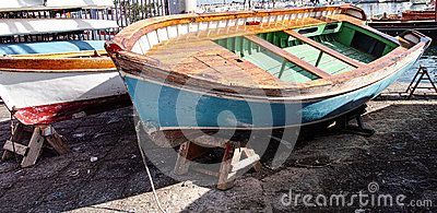 Old wooden boat in the harbour of naples