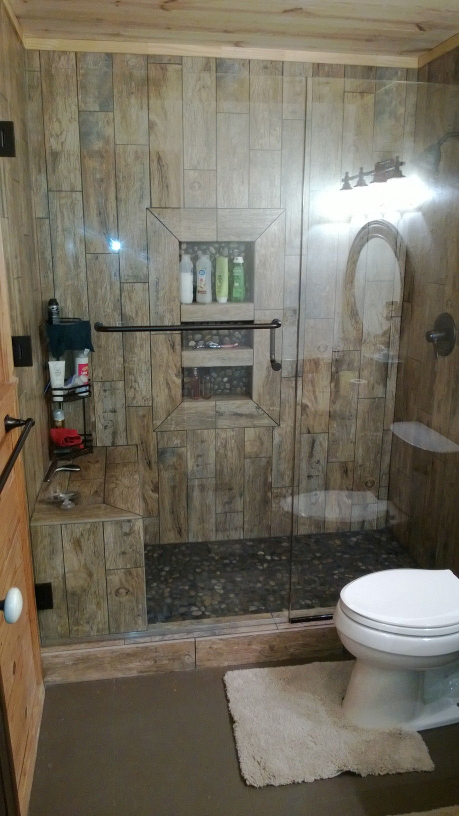 Rustic shower bathroom showers pinterest rustic for Cabin shower tile ideas