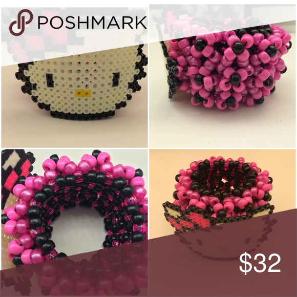 "Hello Kitty Kandi Cuff Brand: KandiKraverCreations by Jasmine Pricing: $25 (etsy), $32 (on poshmark)  A pink and black Hello Kitty 3D Kandi cuff.!  These are made to order so allow 1 to 3 days to make and 2 to 5 days to ship. If you have any questions or would like a customized order let me know! :)   Follow my etsy page at ""KandiKraverCreations"" KandiKraverCreations Jewelry Bracelets"