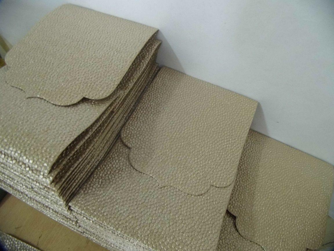 Embossed paper pocketfolds