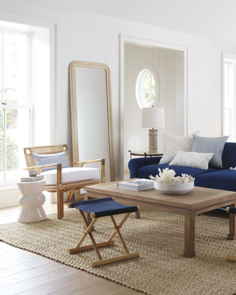 Stunning living room with woven armchair and navy blue sofa on thou swell thouswellblog