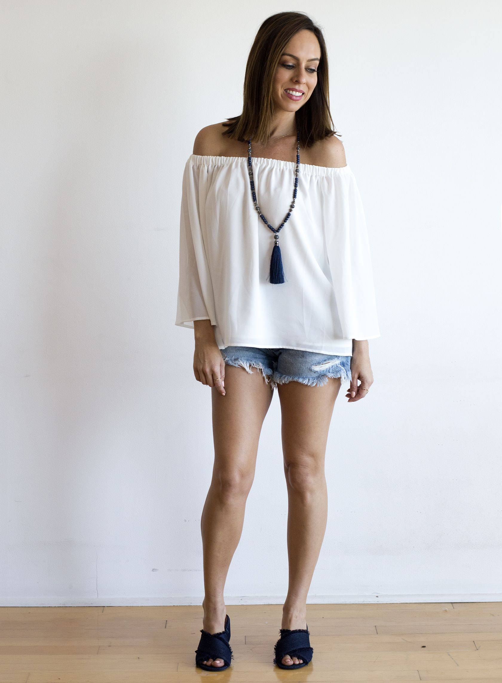 ea7ae272ec6 Sydne Style shows how to wear the off the shoulder trend with summer outfit  ideas with shorts