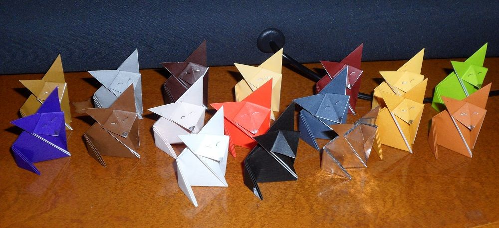 A family of 17 origami foxes that I made for an author whose books I love.