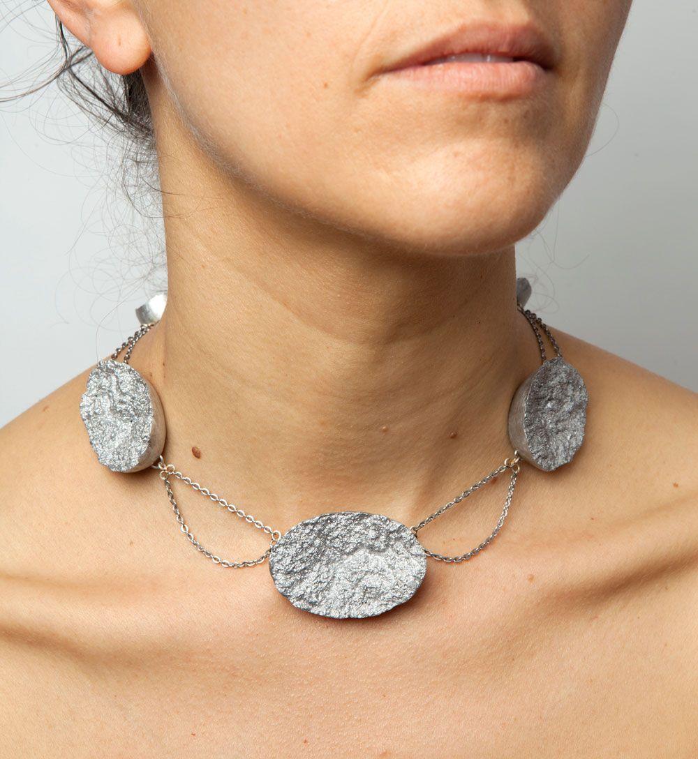Barbara Schrobenhauser. Necklace: Surfaces, 2015. Aluminium, stainless steel. Photo by: Mirei Takeuchi. On Model.