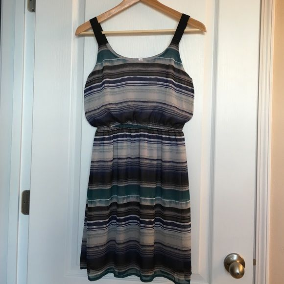 Dressy sundress Perfect little sundress could be done up with fancy heels and a patent belt or just a pair of flip flops on a hot summer day!  Fully lined, never worn. Xhilaration Dresses